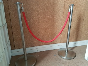chrome_stanchion_with_red_rope_586797004